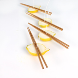 Allowing the wax to set-up using chopsticks to keep the wicks straight